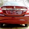 Maruti-Swift-Dzire-rear-view-in-firebrick-red