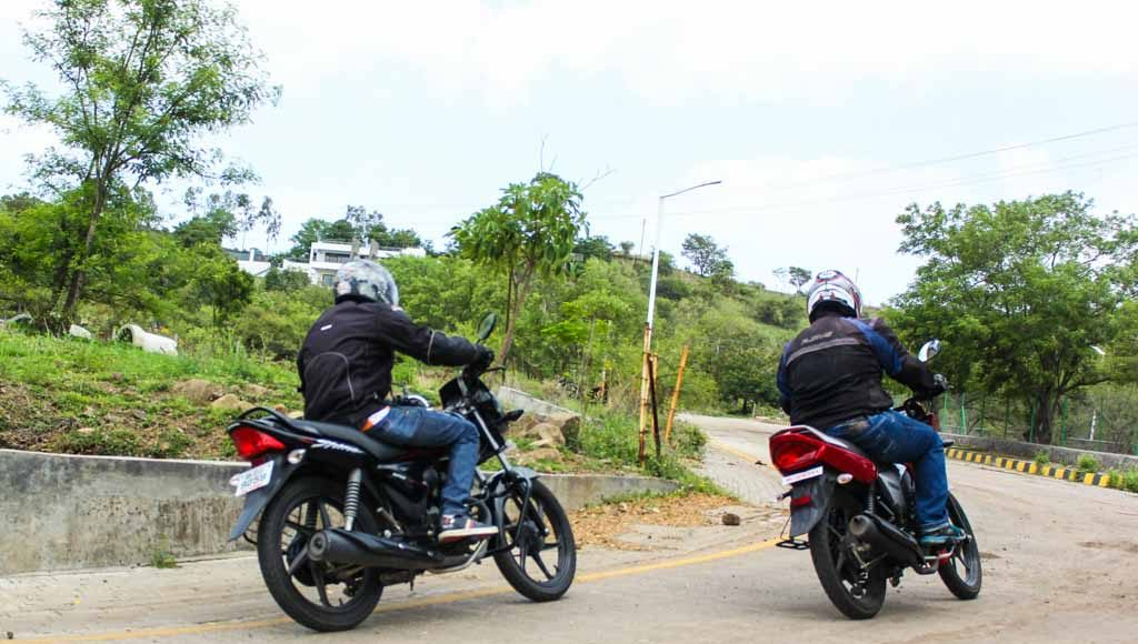honda shine vs yamaha saluto disc brake