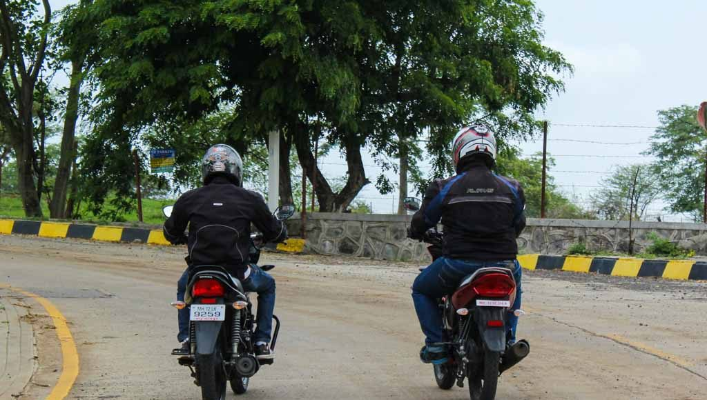 honda shine vs yamaha saluto review
