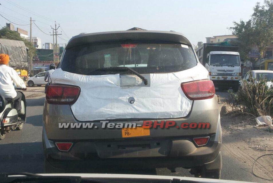 mahindra kuv production version spotted   camouflages