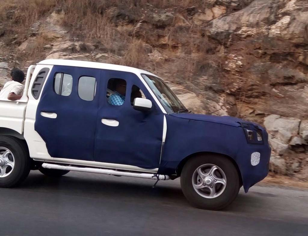Mahindra scorpio getaway facelift spied testing on road side view