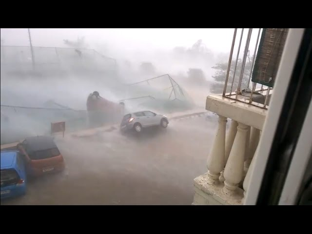 Car Blown Away due to Cyclone Vardah in Chennai