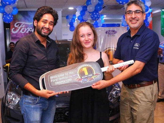Anurag Mehrotra, President & MD, Ford India handing over Ford Freestyle to Ford's One Millionth Indian Customer - Nikhil and Alexandra Kakkar