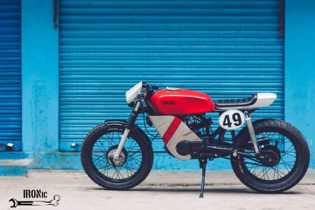 this modified yamaha rx100 café racer is ready for battle