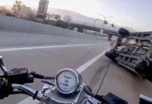 What Would A Biker Do When SUV Barrels Towards Him? - Video