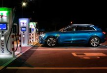 Audi e-tron side profile and charging