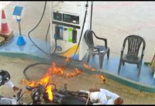 motorcycle catches fire at petrol pump