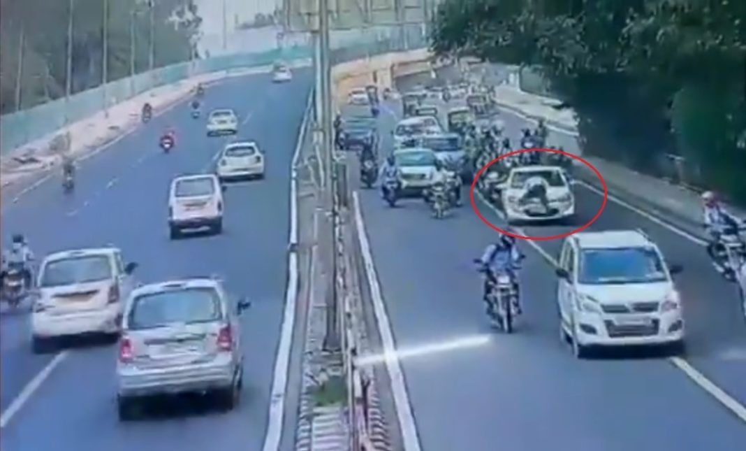 Traffic cop dragged on car bonnet by offender