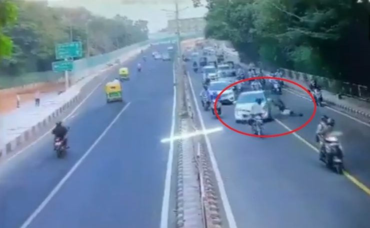Traffic cop dragged on car bonnet by offender 2