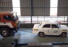 Hindustan Ambassador EV towing a Bharat Benz truck