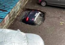 Car falls into sinkhole
